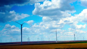 Wind Turbines With Turquoise Sky, Green Energy. Time Lapse, Zoom Out. Concept Of Using Natural Resources Intelligently. Wind energy turbines are one of the stock video footage