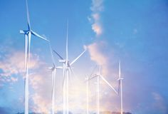 Wind turbines under the blue sky. Wind turbines generating elect. Ricity Stock Images