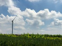 Wind turbines under blue sky and white clouds. 。This is the grassland road in Zhangjiakou, Hebei, China stock image