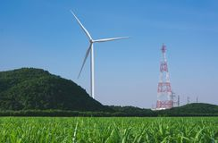 Wind turbines under the blue sky. Wind turbines generating elect. Ricity Royalty Free Stock Images