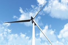Wind Turbines under cloudy blue sky Stock Image