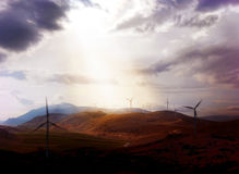 Wind turbines under dramatic sky with in-depth focus Stock Images