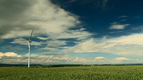 Wind Turbines under a partly cloudy sky stock footage