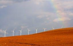 Wind turbines under a stormy sky II stock photos
