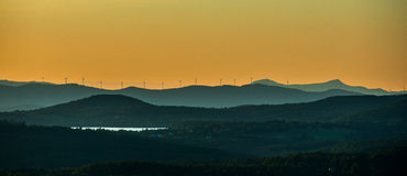 Wind Turbines on Vermont Ridgeline. Wind turbines stretch across a ridge-line in northern Vermont. A subject of much controversy, many Vermonters object to the Stock Image