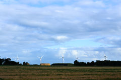 Wind turbines. View of wind turbines across a field Royalty Free Stock Photos