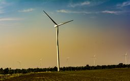 Wind Turbines on warm sky background stock photo