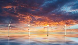 Wind turbines on water. Sunset. Landscape royalty free stock image