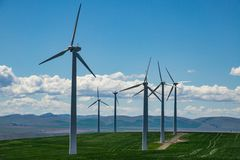 Wind turbines and wheat fields in Eastern Oregon. Wind turbines rising above wheat fields in Eastern Oregon Stock Photography