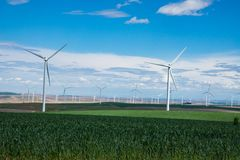 Wind turbines and wheat fields in Eastern Oregon. Wind turbines rising above wheat fields in Eastern Oregon Royalty Free Stock Image