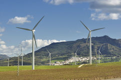 Wind turbines, white village Stock Photography