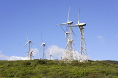 Wind turbines, white village Royalty Free Stock Photos