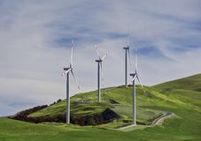 Wind turbines at a wind farm on a hill. Creating renewable energy in Montenegro royalty free stock images