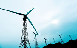 Wind turbines in a wind farm Stock Images