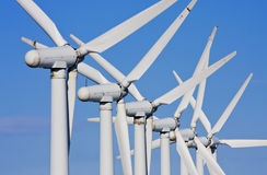 Wind turbines in windfarm. Detail view of windmills in a windfarm royalty free stock image
