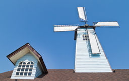 Wind turbines and window on roof Royalty Free Stock Images