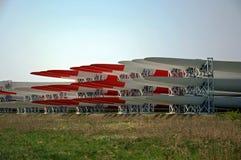 Wind turbines wings lying on field. Wind turbines wings lying on field Royalty Free Stock Images