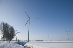 Wind turbines in winter landscape Royalty Free Stock Images