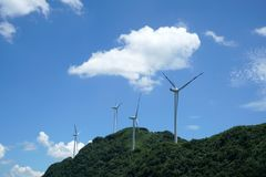 Wind Turbines In China. Wind turbines is working under the blue sky.It provides clean electronics power. It`s taken in Chongqing, China Royalty Free Stock Image