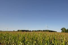 Wind-turbins,farm-land royalty free stock photography