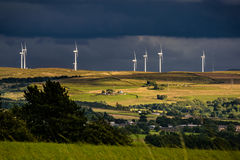 Wind turnbines on the hill with blue clouds Royalty Free Stock Images