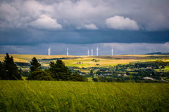 Wind turnbines on the hill with blue clouds Stock Images