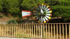 Wind turning slowly blades of weathervane windmill by road, weather forecast. Stock footage stock footage