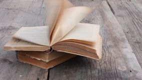 Wind turns the pages of an old open book stock footage