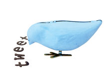 Wind up bird eats letters Royalty Free Stock Photos