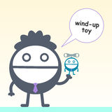 Wind up. A cartoon business man with a wind up toy Stock Photo