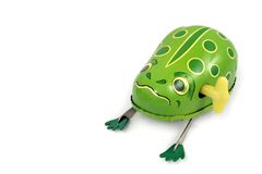 Wind-up frog. Wind-up toy frog resting on a white background Stock Photography