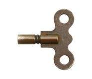 Wind up key. Vintage wind up key isolated on white background Stock Images