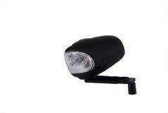 Wind up LED lamp. Black wind up LED pocket lamp Royalty Free Stock Photography