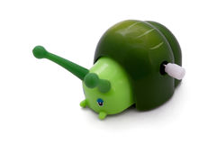 Wind-up snail. Green wind-up  toy snail isolated on white Stock Images