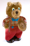 Wind up teddy bear. Wind-up teddy bear with brass cymbals, isolated against a white background Royalty Free Stock Image