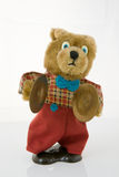Wind-up teddy bear. With brass cymbals, isolated against a white background Stock Photography