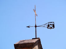 Wind vane. An iron wind vane, at the roof of the church of Laudun village, France Stock Photos