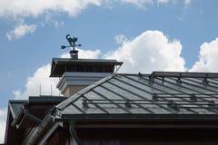 Wind vane cat roof sunny day stock image