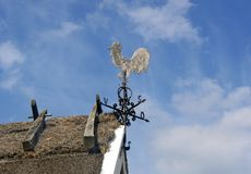 Wind vane with cock Royalty Free Stock Image