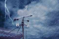 Free Wind Vane On House Roof With Background Of Storm Raining Stock Photos - 101225863