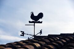 Wind Vane Beside Roof Stock Images