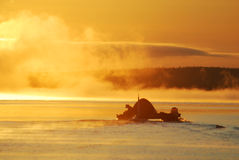 Wind of wandering. Siberia. Raft in the mist. Wind of wandering. Siberia. Raft with tourists is moving in the clouds of sunny mist Royalty Free Stock Image