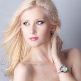 Wind and Watch. An image of a beautiful teenager with blowing hair wearing a watch Royalty Free Stock Photos