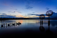 Wind and water. In the evening, the beautiful waterfront restaurant royalty free stock photo