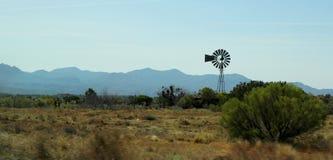 Wind water pump. In a Arizona landscape stock photo