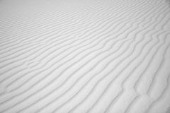 Wind waves in white sand Stock Photo