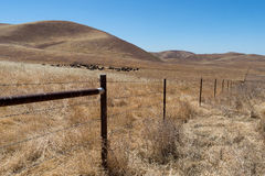 Wind Wolves Preserve fenceline. The preserve is managed by the Wildlands Conservancy and covers 90,000 acres in the San Emigdio Mountains at the southern end of Royalty Free Stock Photography