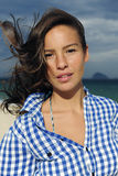 Wind: woman with tousled hair at the sea Stock Images