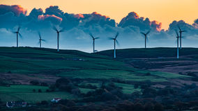 Wind and Wool in Wales. Grazing sheep and the turbines of the Taff Ely Wind Farm on Mynydd Maendy, Tonyrefail, Rhondda, Wales Stock Photography