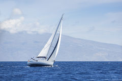 Wind in yacht sails with beautiful sky. Royalty Free Stock Photo